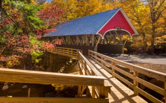 Red covered bridge in Fanconia New Hampshire during Fall season